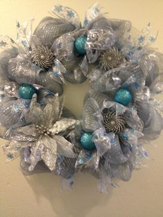 Ice Blue and Silver Deco Mesh Christmas Wreath with Silver Glitter Poinsettia https://www.facebook.com/pages/Kattfish-Kreations/659509324079375