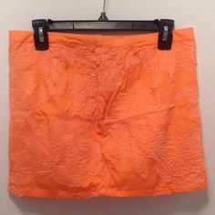 Buffalo David Bitton Orange Skirt Sz 6 This is a fun rough girly look skirt.  Embroidery. The style name is Callan (which is also on the label),  Style#: WB1052.  SKU#: 826012529489.  Made of 100% Cotton.  Made in India.  RN#: 85706.  CA#: 17311.  Retails for $79.  The color is more of a mango color.   Happy Poshing! Buffalo Skirts