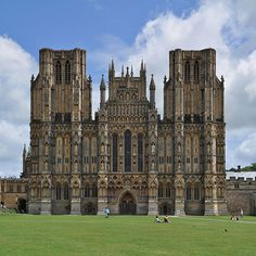 Wells Cathedral is a Church of England cathedral in Wells, Somerset, England. Built between 1175 and 1490, the nave and transept are examples of the Early English style of architecture. It was largely complete at the time of its dedication in 1239.
