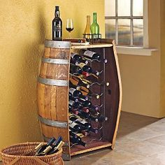 Oak Wine Barrel Bottle Rack by Wine Enthusiast. $549.00. From California's finest wineries to your home. How fitting a home for 32 of your beloved bottles: a repurposed oak wine barrel complete with original steel hoops and bunghole. Naturally wine-stained inside. May be stamped with vineyard name. No assembly. Size: 35-3/4'H x 23'W x 16-1/2'D