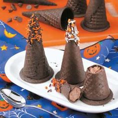 Mousse-Filled Witches' Hats - i could do this, only with candy on the inside. cover the cone with chocolate, put candies inside, drop a circle of chocolate on wax paper and let it cool, then put chocolate on rim of cone and set on chocolate circle (so candies don't stick to choc cirle)
