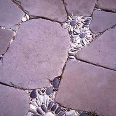 Fill the cracks in your concrete with fresh concrete and pebbles...