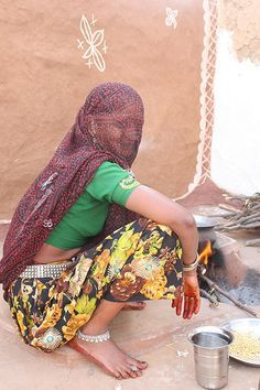 A village woman cooking , India