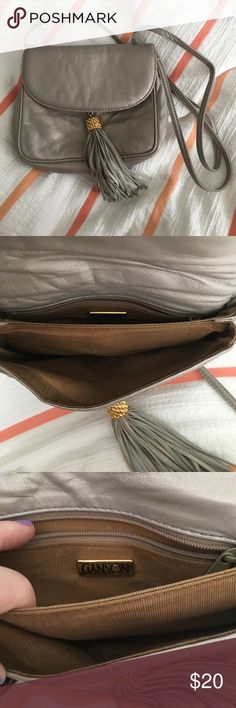 Fun Vintage purse Super cute vintage purse by Ganson. Owned by my Grandmother for years, but she doesn't need it and nearly do I! EUC. Sweet creamy silver color with fun tassel. Lots of little pockets Ganson Bags Crossbody Bags