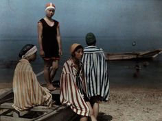 Bathers, Japan  Photograph by Kiyoshi Sakamoto  Japanese students await a turn in the water for a swimming lesson in this 1927 autochrome.