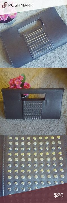 BRAND NEW GUNMETAL GREY CLUTCH Grey clutch with magnetized buttons for securing closure. Zipper pouch in the middle for make up etc. This clutch is brand new and has never been used. Does not have tags but has the plastic on zipper and buttons.  OFFERS WELCOME Charming Charlie Accessories