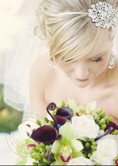 Love the framing of this pic. The jewel in her hair accentuates what would otherwise have been lost to the flowers.