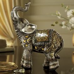 Figurines & Statues - Ancient treasure or blingy collectible elephant? However it strikes you, this sculpture is all about decorative details. Buy Now, Pay Later Credit Shopping at Seventh Avenue! Elephant Head, Elephant Love, Elephant Stuff, Colorful Elephant, Elephant Parade, Ganesha, Oriental, Elephant Figurines, Crackle Glass