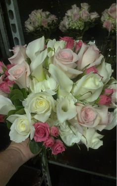 Look how the bright pink sweetheart roses really pop in this wedding bouquet with calla lilies, light pink and white roses. Good luck to the bride and groom! americasflorist.com