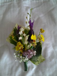 Yellow and purple corsage on a magnet