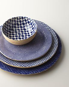 Mix of blue and white patterns on ceramic plates and bowl in different blues and patterns, Horchow
