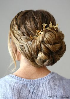 This four strand braid updo is elegant and formal; a perfect hairstyle for an evening out. These styles are my absolute favorite and something I love to change up slightly and wear whenever I can. This past week AJ graduated from Officer Training School in Alabama and I was able to wear a similar style to the Dining Out. Since I was shorter on time I swapped out the four strand braid for a simple lace braid and did a smaller, wrapped bun. It was perfect for the evening which called for…