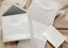 Embossed floral pattern with crystal foil. Names and favorite quote are featured on the front.