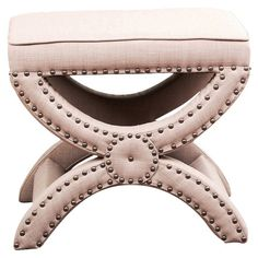 Add a stylish touch to your den or living room with this chic ottoman, showcasing beige upholstery and nailhead trim.   Product: