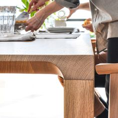 The Radii Dining Table by Bensen is a solid wood dining table with subtle detailing that lends refinement to its simple appearance. Dining Table Legs, Solid Wood Dining Table, Sofa Design, Furniture Design, Idee Diy, American Walnut, Scandinavian Furniture, Steel Bar, Cabinet Makers