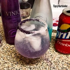 ALLURING LULLABY 1 oz. (30ml) Viniq Liqueur 1/2 oz. (30ml) Hpnotiq Liqueur 1/2 oz. (15ml) Plum Vodka Cranberry Sprite Purple and White Sugar