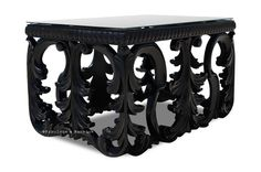 The exquisite Simone coffee table is simply fabulous with its elaborate ornamental legs finished in black lacquer with a mirrored top. The Simone coffee table will add elegance and style to any living or family room and will easily become your favorite piece!  Size: W: 24 H: 20 D: 36 (approx)