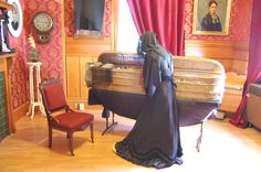 """The parlor doubled as the """"death room"""" & was an important part of funerals for most of the 19th century. The deceased were laid out for final respects. This custom continued 1890 until the end of WWII, when most Americans went to doctors offices and hospitals. Eventually the """"death room"""" became the """"living room"""".  (Notice covered mirrors in this scene - a Victorian superstition). @ The Victorian Mourning Exhibit at the Petaluma History Museum, Petaluma CA Oct 2013 Photo by Marianne Riddle"""