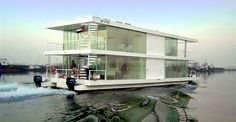 cool houseboat, love all the glass