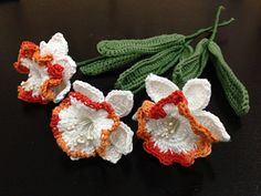 """I made this flower as an entry for the FB group Passionate About Crochet theme """"India Independence Day."""" The bright colour of saffron gives a very nice touch to the pure white I am using and the green softens the shades, giving a pleasant looking piece of crochet art. One complete stem takes about 60 – 90 minutes to make. There are two options to finish the flower; ruffle and thin edging and both patterns are included."""