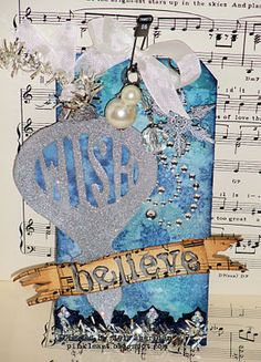 Believe or wish on sheet music with shimmer.