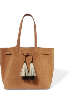 """Loeffler Randall describes its bags as """"directional and timeless."""" This light-brown suede tote is trimmed with black and ecru horse hair tassels and has a braided drawstring top so you can cinch or expand its shape. Slide your tablet, wallet and notebook into the spacious canvas-lined interior."""