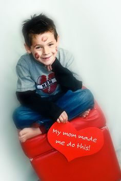 valentines  yup this is too funny and so something I would have the kids do! I think I would have the girls in there with lipstick on then have the boys covered in kisses! Fun vday card idea!