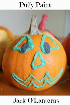 Decorating pumpkins with puffy paint - Halloween art kids will love!