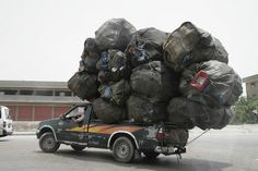Plastic recycling, overloaded truck. by GavinBell, via Flickr