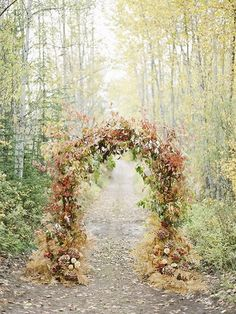 An Arbor of Fall Foliage This ceremony altar is absolutely the definition of a fall wedding, don't you think? We love how the organic, colorful structure blends into the grass below and the natural golden foliage behind. Fall Wedding Arches, Wedding Ceremony Arch, Fall Wedding Flowers, Fall Wedding Decorations, Fall Wedding Colors, Ceremony Backdrop, Autumn Wedding, Wedding Ceremonies, Wedding Centerpieces