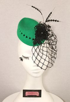 Emerald green felt fascinator with black felt backed cutt-outs, vintage black veiling, black feather flower and feather accents