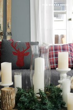 It's me, Emily from The Wicker House and I wanted to stop by today and share this easy plaid deer pillow that I made for our home this holiday season.