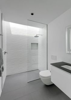 grey flooring Grey floor tiles have been paired with textured white tiles to create a contemporary bathroom, while a skylight located above the shower adds a touch of natural light to the space. Bathroom Layout, Modern Bathroom Design, Contemporary Bathrooms, Bathroom Interior Design, Bathroom Ideas, Bathroom Showers, Contemporary Shower, Shower Rooms, Showers For Small Bathrooms