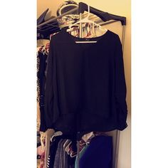 Black long sleeved shirt Black long sleeved shirt with lace design on the sleeves! Never worn Monteau Tops Blouses