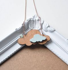 Made in Ireland. The chain is an vintage style antiqued copper with a lobster clasp, glass bead and 'artysmarty' rabbit tag. There are also matching brooches in this series. Each necklace comes packaged in a lovely red box and we can wrap and include a gift tag with a personal message also if you'd like; please make a note at the checkout.Wood, antiqued copper, glass bead.