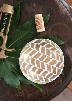 Turn blank plates into works of art with this simple DIY painted herringbone craft.