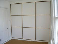 Wouldn't mind replacing the crappy bi-fold closet doors in our bedroom with these one day: Sliding door Japanese style panel wardrobe - Peter Henderson Furniture, Brighton, UK