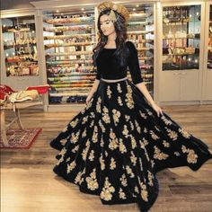 Heavy Embroidered Black Velvet Lehenga Choli.