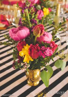 WedLuxe: stripe linens and brights floral centrepieces #wedding