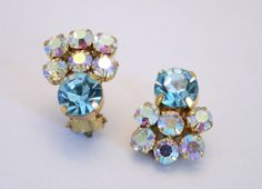 Vintage pale blue rhinestone earrings. Clip by chicvintageboutique, $15.00