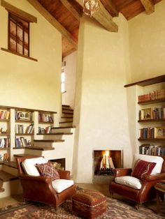 Love the stairs and the bookshelves and the fireplace and...everything