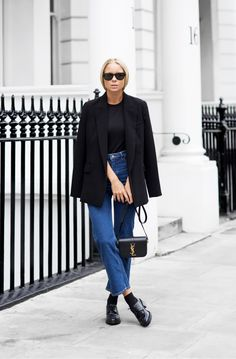 The Best Blogger Street Style for Spring Outfit Inspiration | Blogger 'Victoria Tornegren' in black draper blazer, high waist jeans, and leather loafers