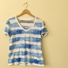 GAP s/s tee I love this blue water color striped tee! It has a bit of wear, as seen in the photo (very minor pilling, as t-shirts do) but it's in great shape! GAP Tops Tees - Short Sleeve