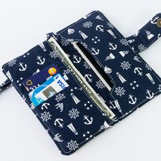 Women iPhone 6+ wallet, made with white anchor and marine stuff fabric pattern. It's very beautiful and elegance. It's suitable for every woman. https://www.etsy.com/shop/FunnySweetie Visit my women iPhone wallet shop to see more design.