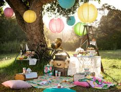 Decor - love the hanging paper globes and sheer table cloth