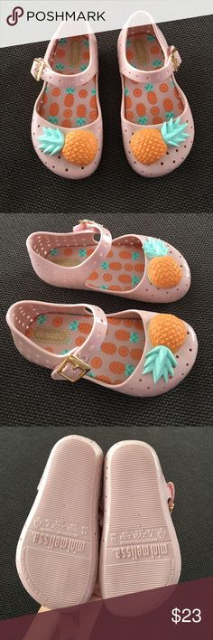 Mini Melissa Pink Pineapple Shoes Sz 7 New no box. Pink Furadinha is back featuring a new pineapple motif on Mini Melissa's famous Mary-Jane style. The patterned insole adds that final fruity touch, and the Velcro mock-buckle strap ensures that it easy to take on and off. a perfect summer shoe for a stylish little lady. Melissa shoes do not really stretch. Size 7. Mini Melissa Shoes Baby & Walker
