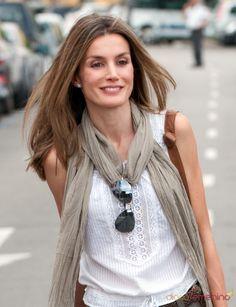 Princess Letizia of Spain. Relaxed gauzy scarf, white blouse, aviators.