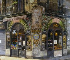 Antigua Casa Figueras. Barcelona. An elaborately decorated cake shop built  by Antoni Ros i Güell (1902). There is alot of emphasis on mosaics, stucco, wrought iron, stained glass and wooden furniture.