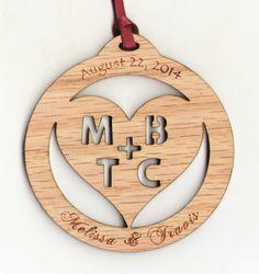 Love the unique style of this cut out & engraved oak wedding ornament.  #weddingfavor #woodornament #customornament #engraved #engravedwood #ornament