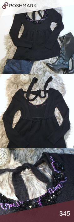 """Free People Open Back Jeweled Sweater AMAZING sweater for the Winter! It is empire cut into a babydoll fit, with an incredible open back that ties at the neck. It has sequin floral embroidery at the neckline with a pop of color. Super sexy sweater, while keeping you warm at the same time! 51% Wool, 31% Nylon, 17% Rabbit Hair/ Angora. Dry clean only. Shoulder to empire seam 11"""", shoulder to hem 23"""", Bust 28"""", shoulder to cuff 25"""". Very gently worn, no missing sequins or beads, in excellent…"""